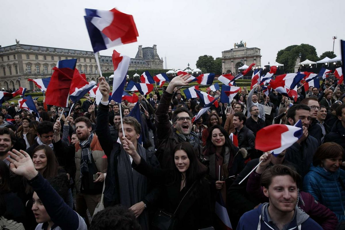 Supporters of French President-elect Emmanuel Macron celebrating his win at the Carrousel du Louvre in Paris, France, 07 May 2017.