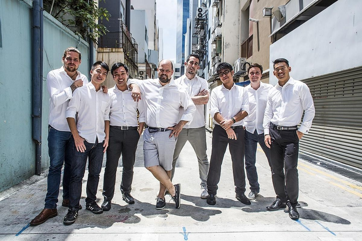 Mr Spencer Forhart (fourth from left) and Mr Paul Gabie (second from right) with their team from 28 HongKong Street.