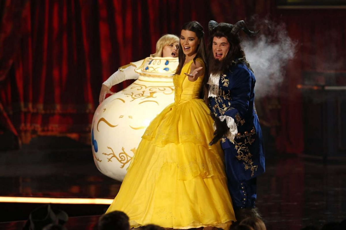 Host Adam DeVine and actress Hailee Steinfeld perform a Beauty And The Beast spoof.