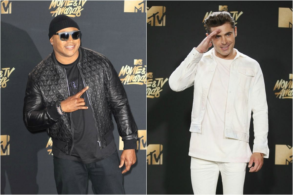 LL Cool J (left) and Zac Efron arrive at the event.