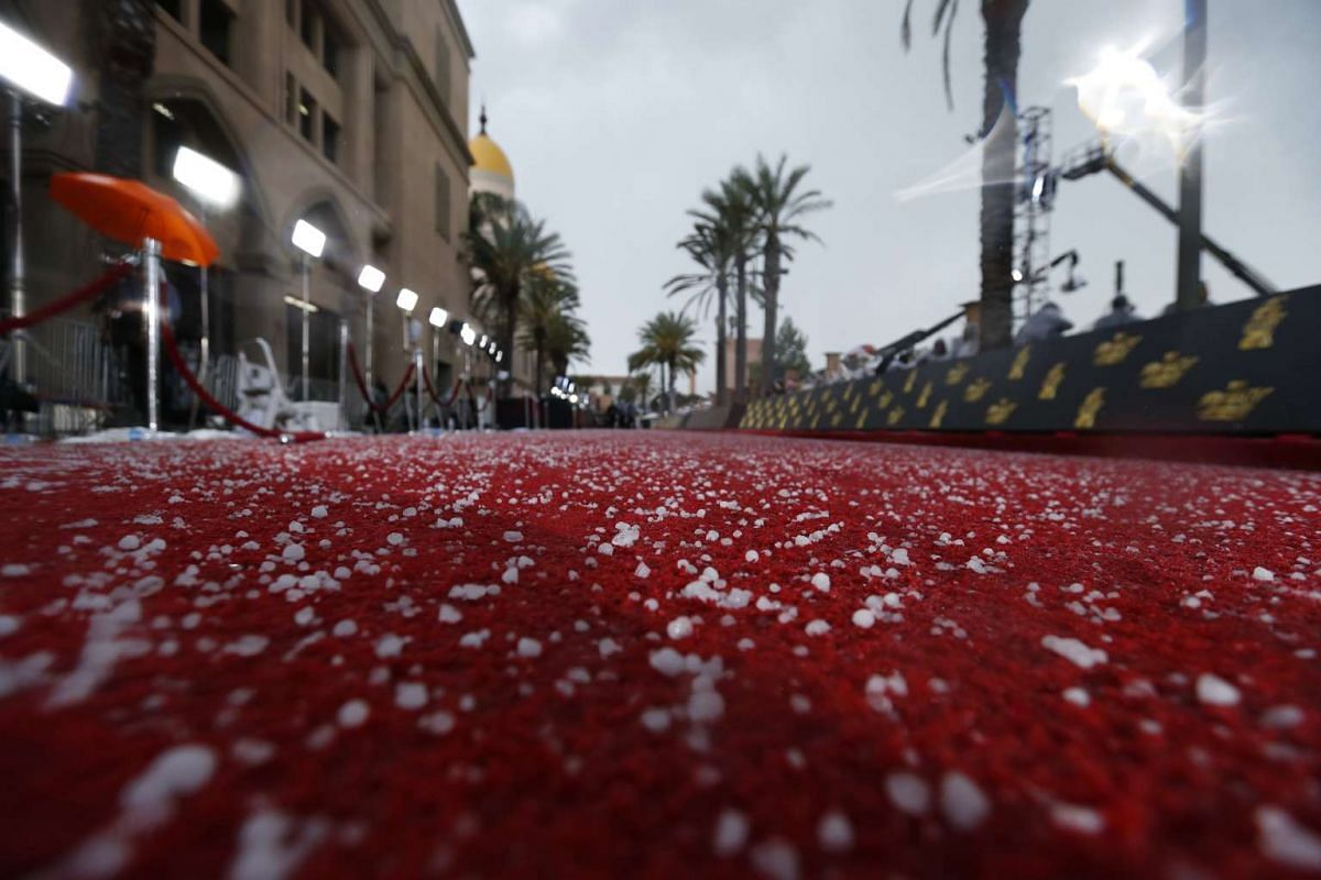 Hail stones on the red carpet following a storm, forcing the ceremony to move indoors.