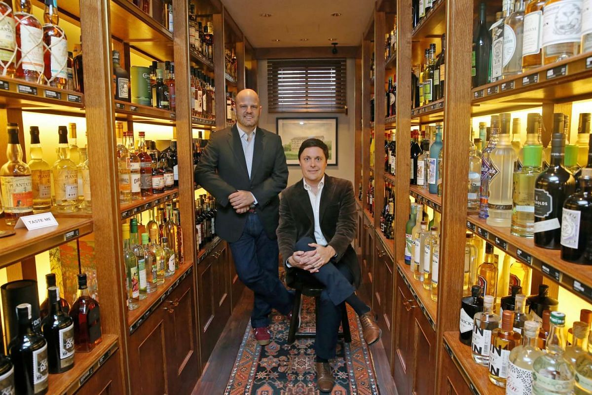 Mr Spencer Forhart (left) and Mr Paul Gabie in their retail bottle shop, The Proof Flat.