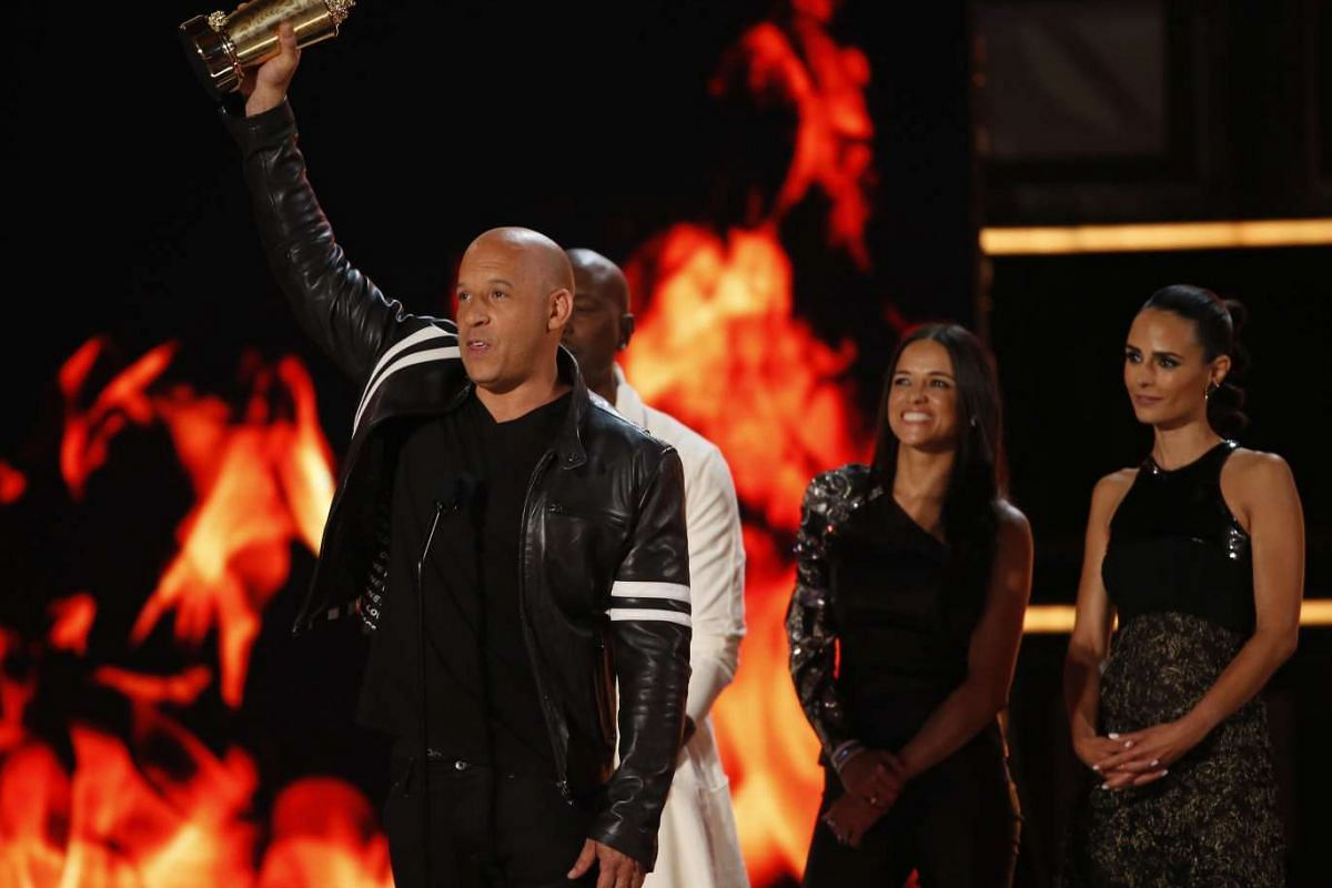 Vin Diesel accepts the Generation Award for The Fast And The Furious along with Tyrese Gibson, Michelle Rodriguez (second from the right) and Jordana Brewster.