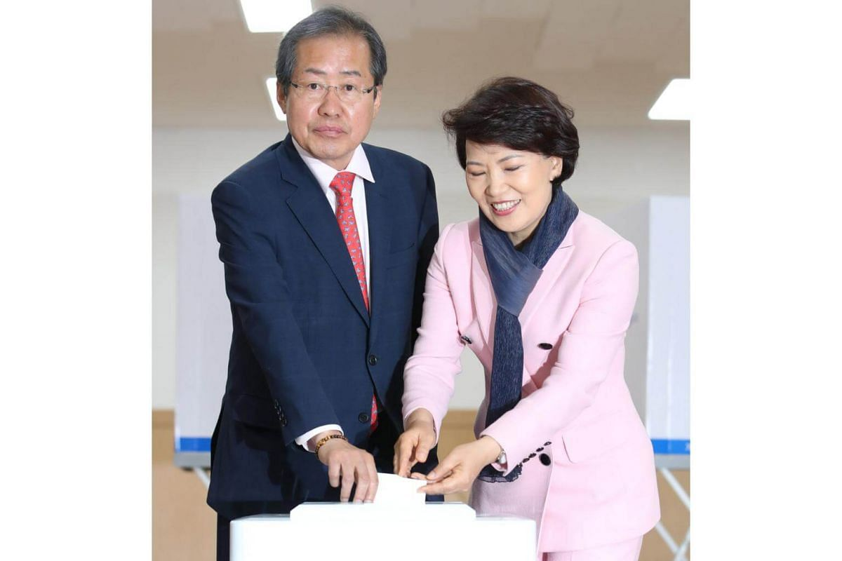 Hong Joon Pyo (left), the presidential candidate of the Liberty Korea Party, and his wife Lee Sun Sam cast their ballots at a polling station in Seoul, South Korea, on May 9, 2017, as voting began across South Korea for a presidential election.