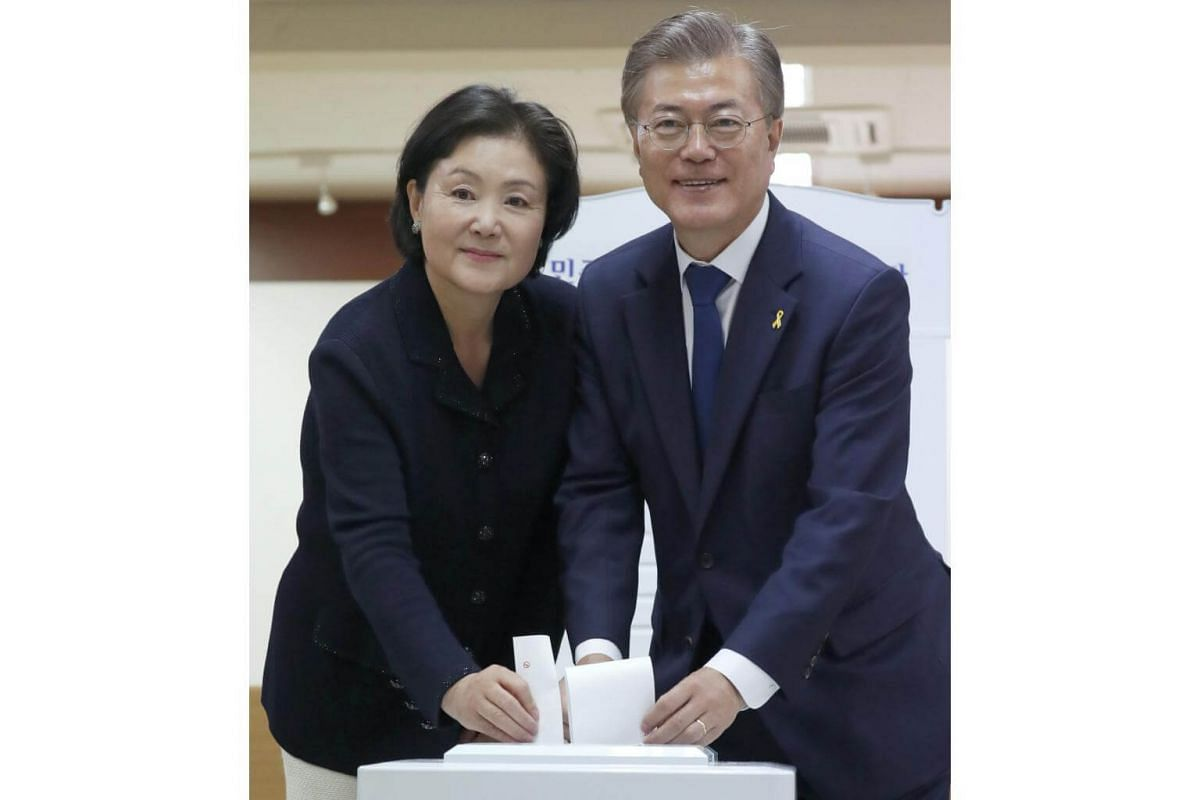 Moon Jae In (right), presidential candidate of the Democratic Party of Korea and his wife Kim Jeong Suk cast their ballots at a polling station in a junior high-school in Seoul, South Korea, on May 9, 2017, as voting began across South Korea for a pr