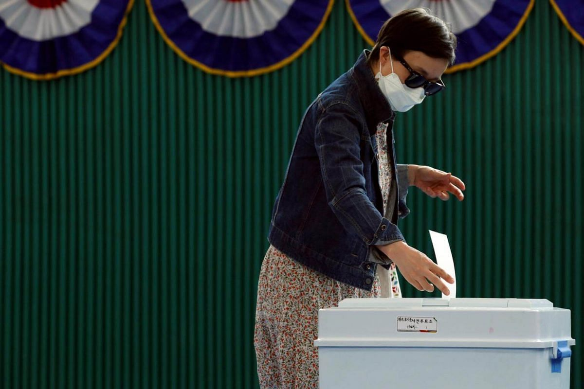 A voter casting her ballot in a box at a polling station during the presidential election in Seoul, South Korea, on May 9, 2017.