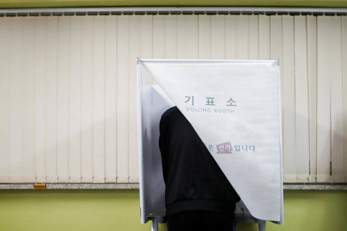 A man votes at a polling station during the presidential election in Seoul, South Korea, on May 9, 2017.