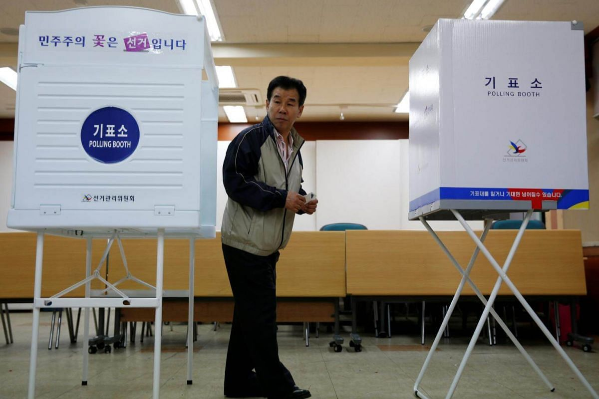 A man prepares to cast his vote at a polling station during the presidential election in Seoul, South Korea, on May 9, 2017.