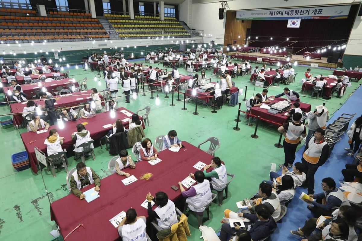 Officials receive instructions before the ballot count for the presidential election in Sejong, south of Seoul, South Korea, on May 9, 2017.