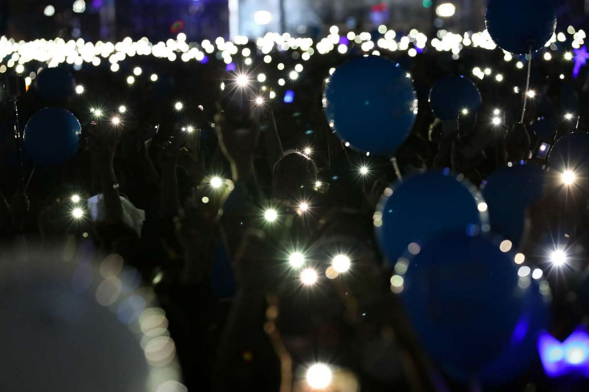 Attendees shining lights from mobile devices during a campaign rally for Moon Jae In (not pictured), at Gwanghwamun Square in Seoul, South Korea, on May 8, 2017.