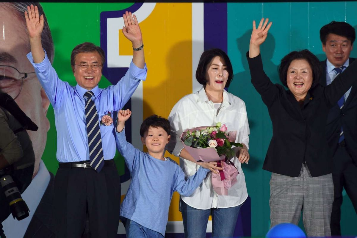 South Korean presidential candidate Moon Jae In (left) of the Democratic Party posing with his family members during his election campaign in Seoul, on May 8, 2017.