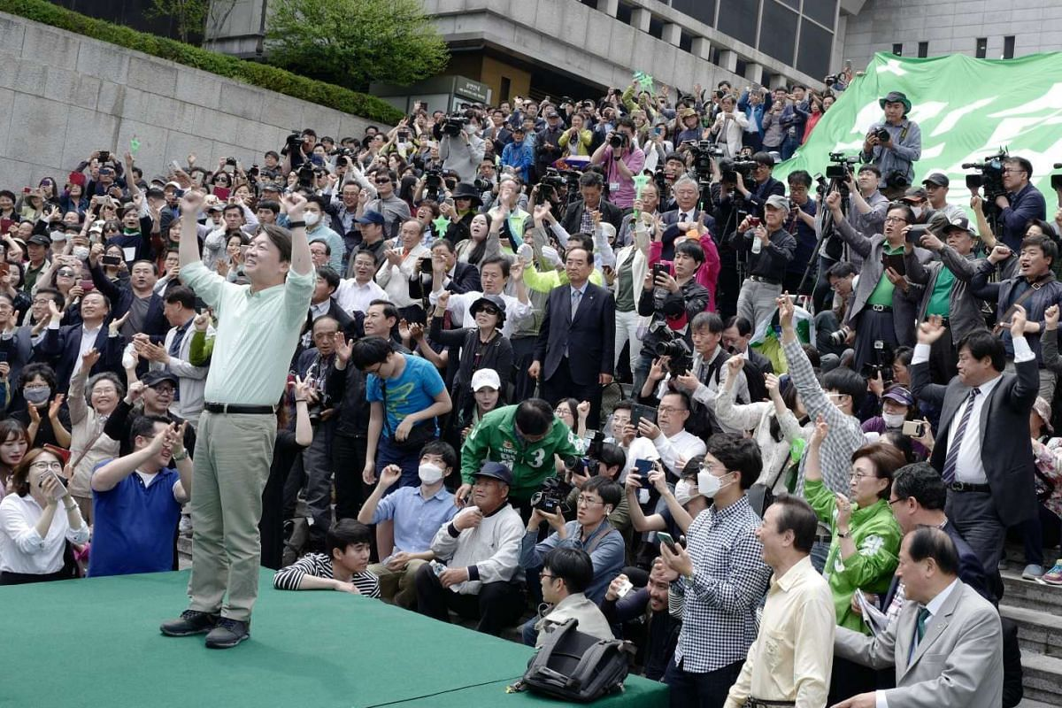 Ahn Cheol Soo (left), the presidential candidate of the centrist People's Party, greeting supporters during a campaign rally in Seoul, South Korea, on May 8, 2017.