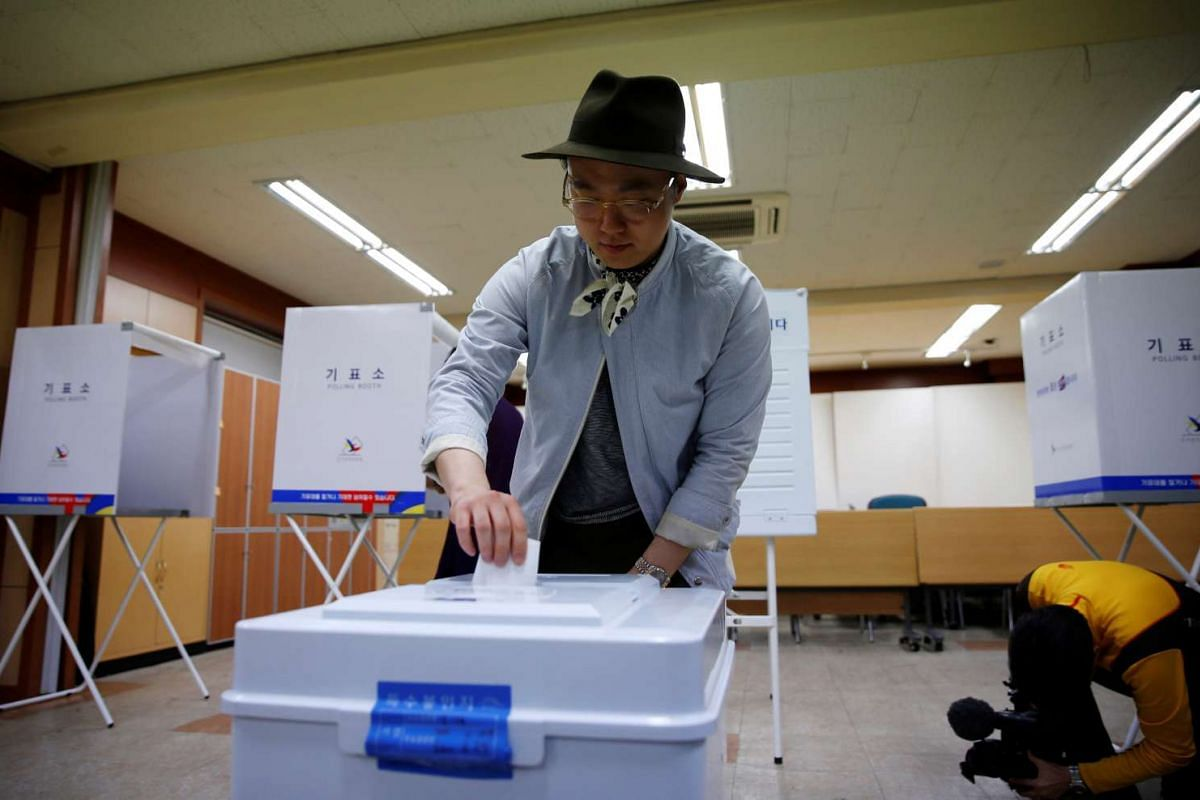 A man casting his vote at a polling station during presidential election in Seoul, South Korea, on May 9, 2017.