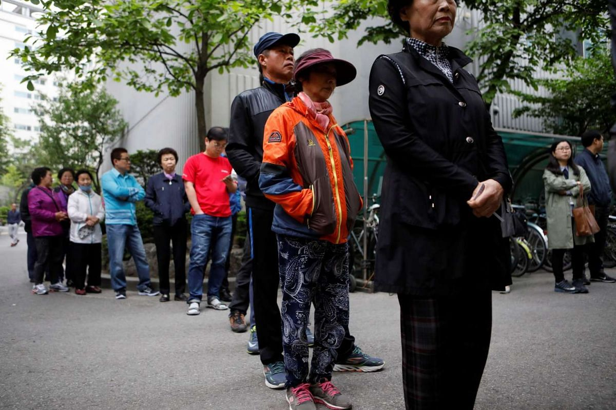 Voters waiting for a polling station to open for the presidential election in Seoul, South Korea, on May 9, 2017.