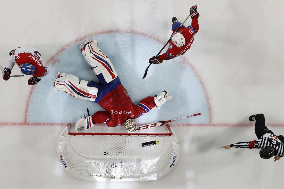 Goalkeeper Lars Haugen of Norway lies on the ice after allowing a goal by Jan Kovar of Czech Republic scored in the overtime.