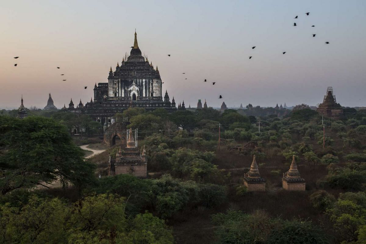 As the sun rises, birds fly over the temples of Bagan, Myanmar, March 15, 2017. The Myanmar government is seeking World Heritage status for Bagan. The bid may succeed because a 2016 earthquake destroyed some earlier restorations.