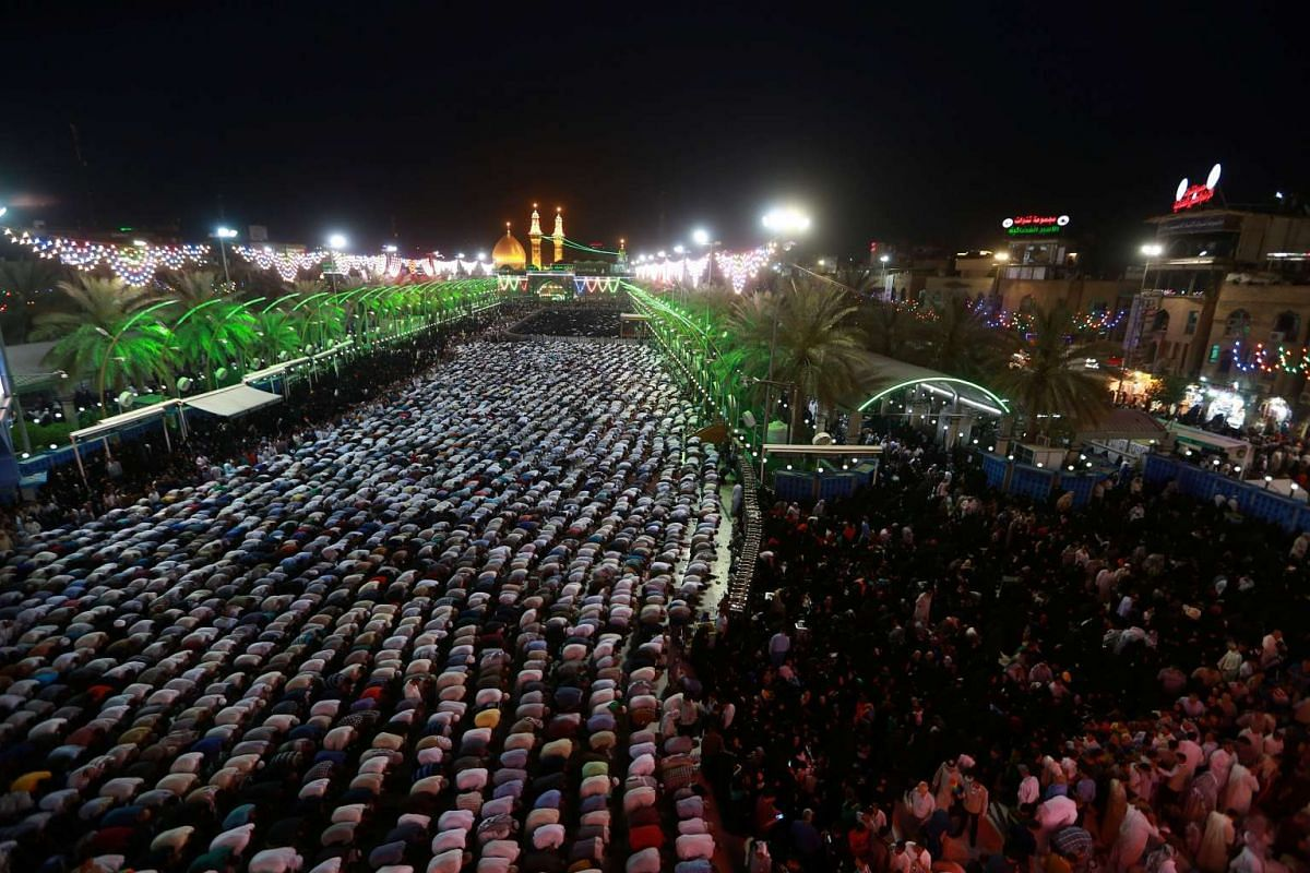 Shi'ite pilgrim gather during a religious rite to mark the birth of Imam al-Mehdi in Kerbala, Iraq May 11, 2017.
