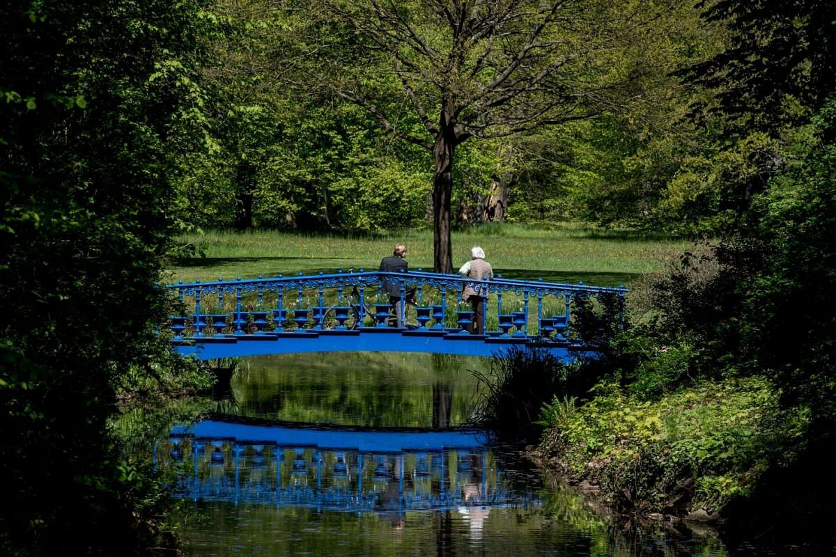 Visitors enjoy the tranquility of the park.