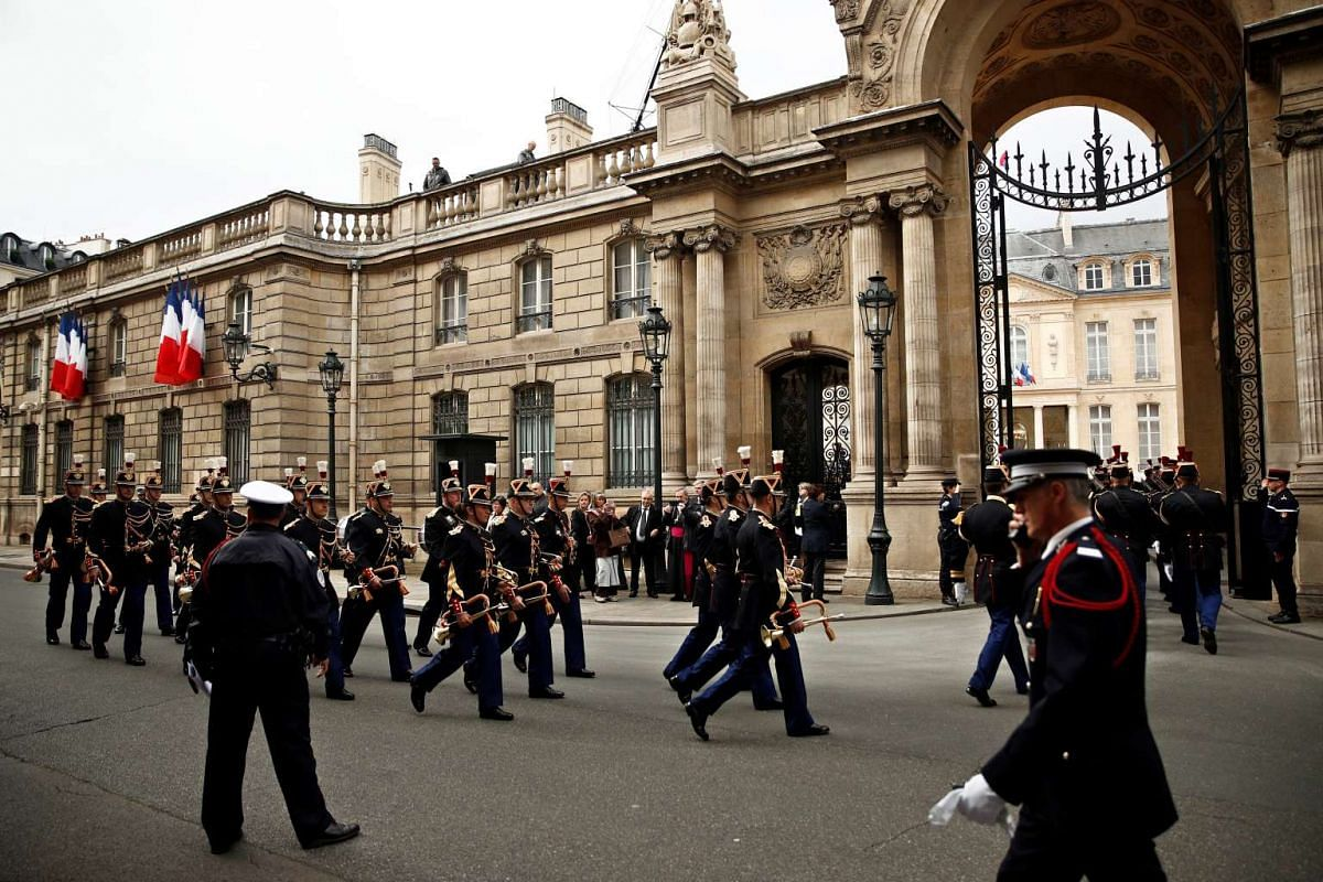 French Republican Guards arrive at the Elysee Palace before the handover ceremony between outgoing President Francois Hollande and President-elect Emmanuel Macron, at the Elysee Palace in Paris, France, May 14, 2017.