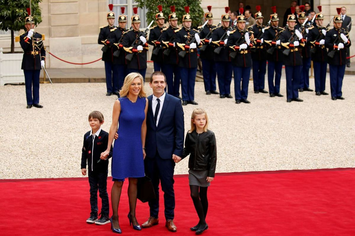 Ms Laurence Auziere Jourdan (second from left), daughter of Brigitte Trogneux, together with her husband Guillaume and their children arriving at the Elysee Palace for the presidential handover ceremony, on May 14, 2017.