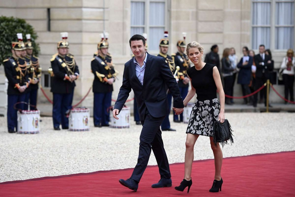 Ms Tiphaine Auziere (right), the step-daughter of French president-elect Emmanuel Macron, and her husband Antoine arriving at the Elysee Palace on May 14, 2017.