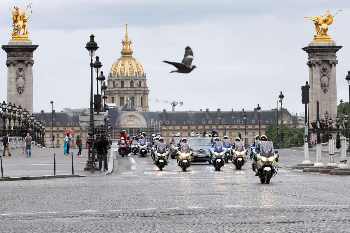 The motorcade of French president-elect Emmanuel Macron going near the Invalides before arriving at the Elysee Palace for the handover ceremony, on May 14, 2017.