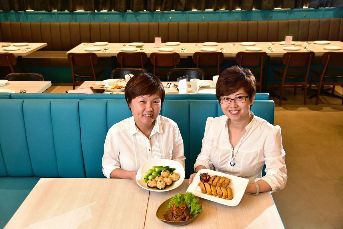 Whole Earth owners Wood Hui Mean (left) and Phyllis Ong in their revamped eatery.