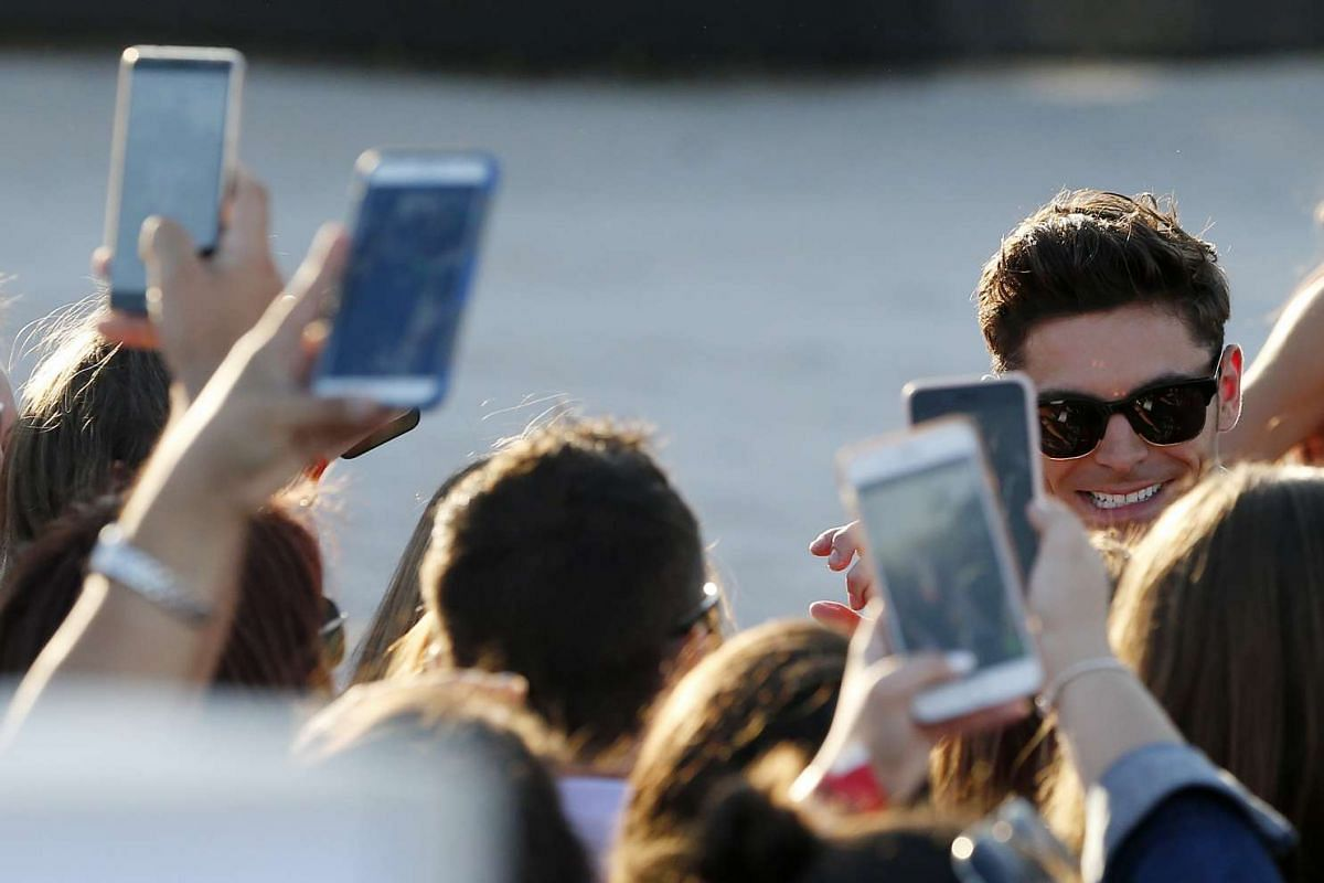 Zac Efron interacts with fans.