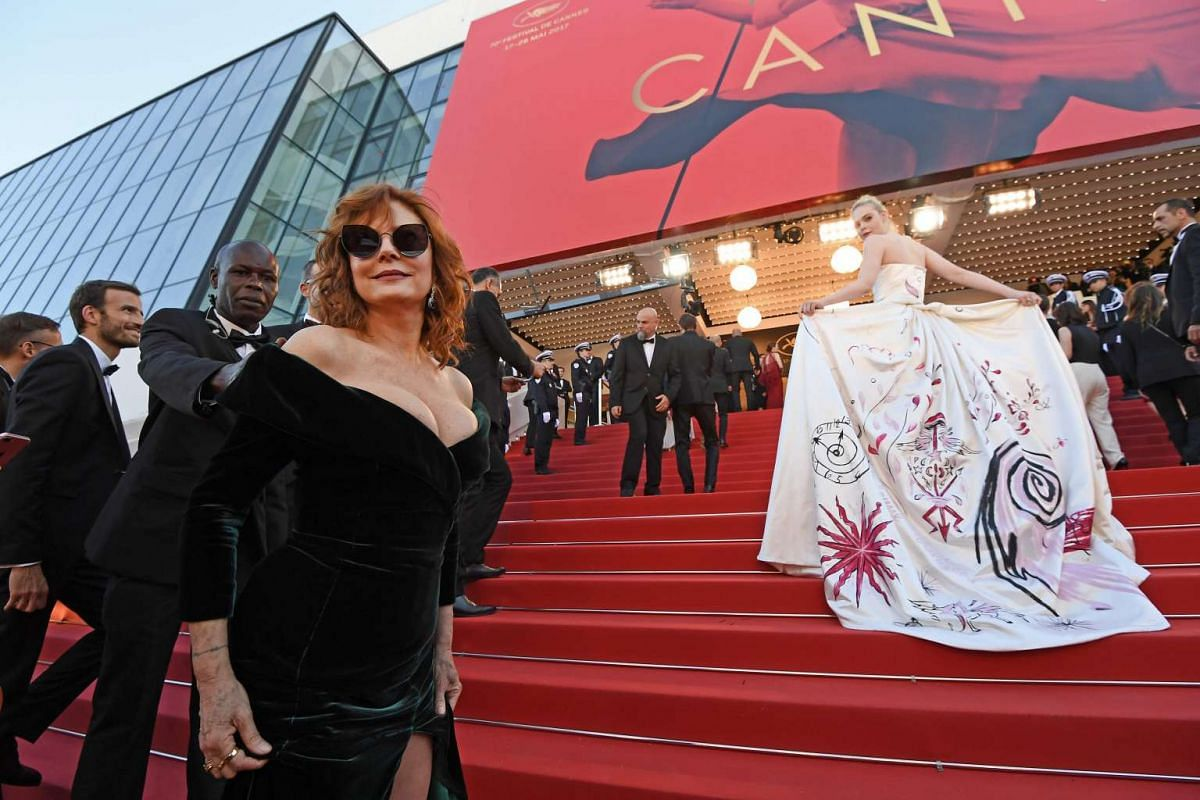 US actresses Susan Sarandon (left) and Elle Fanning, who showed off the details on the train of her dress.