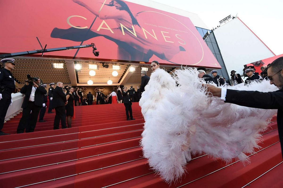 Thai actress Araya Alberta Hargate known as Chompoo in a frou-frou creation as she arrives on the red carpet.