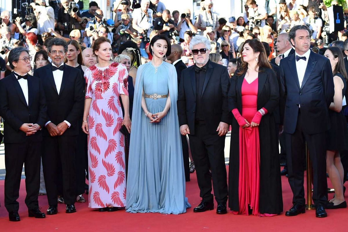 Members of the Cannes jury arrive for the screening of the film Ismael's Ghosts (Les Fantomes d'Ismael).