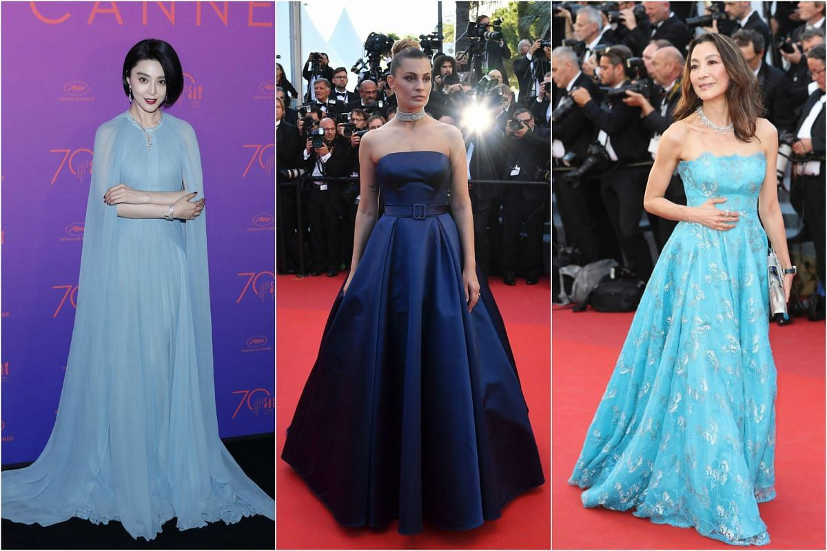 All dressed up in gowns are (from left) Chinese actress and Cannes jury member Fan Bingbing, Italian actress and model Sveva Alviti and actress Michelle Yeoh.