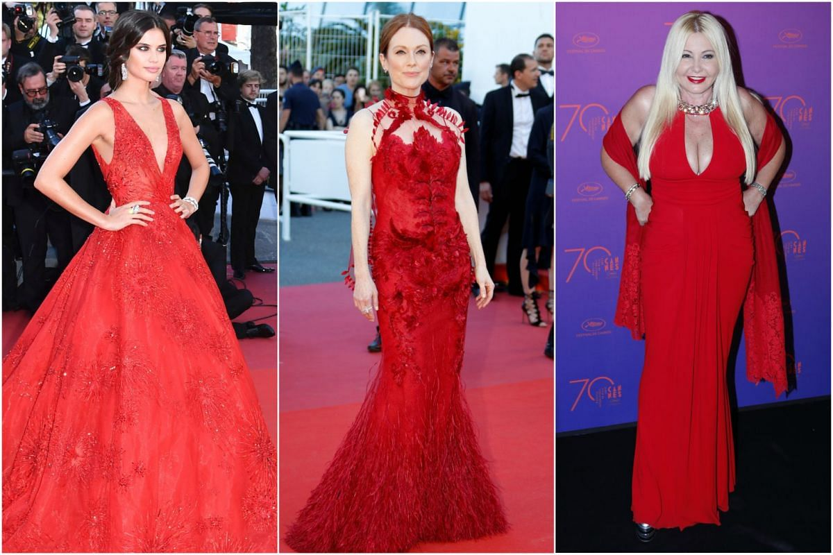 Ladies in red: (From left) Portuguese model Sara Sampaio, actress Julianne Moore and Italian honorary president of Bacardi Group Monika Bacardi.
