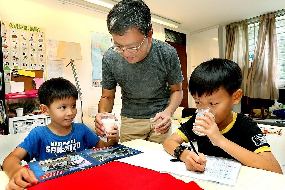 Mr Wesley Loh has been giving his sons Ethan (left), five, and Benjamin, eight, fresh milk since they were about two years old. Mrs Alethia Lee, 29 (with husband Lee Ying Quan, 30) breastfed her son Kester until he was 15 months old before giving him