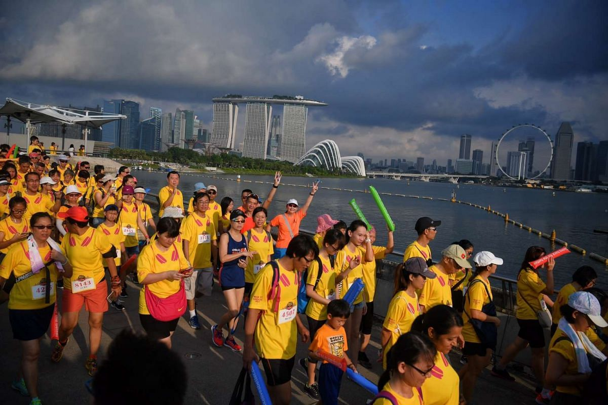 With the Singapore skyline as their backdrop, participants took a stroll at the annual FairPrice Walks With U event at the Marina Barrage on the morning of May 21, 2017. PHOTO: STRAITS TIMES/MARK CHEONG