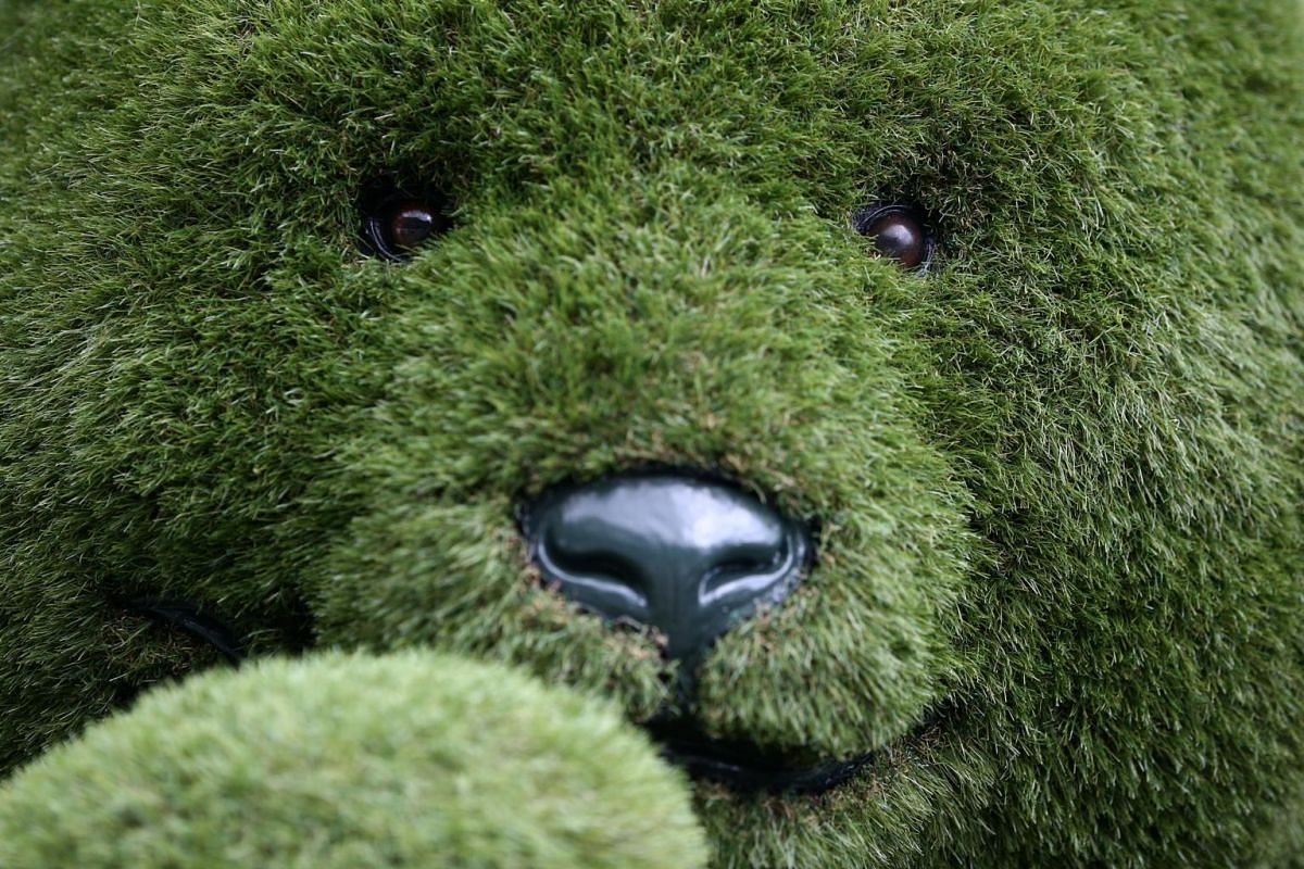 An artificial grass teddy bear is displayed at the RHS Chelsea Flower Show in London, Britain on May 21, 2017.
