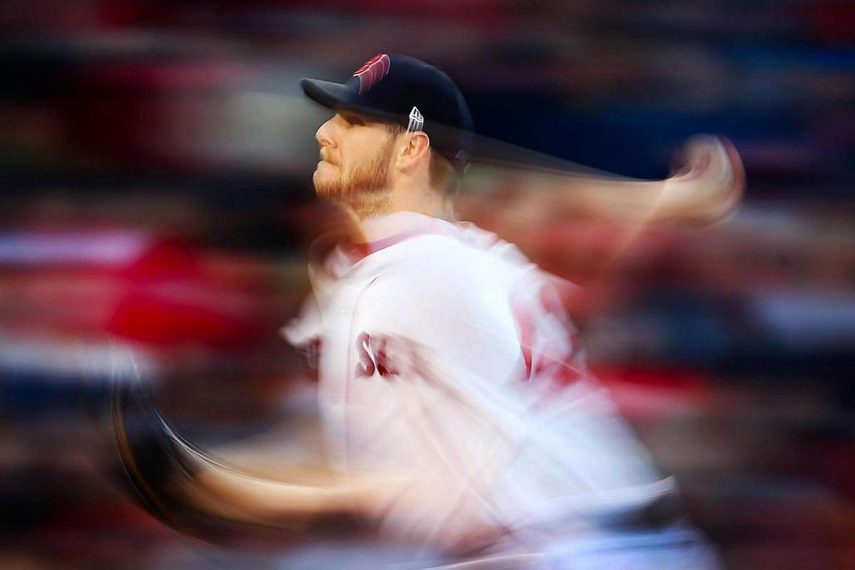 Chris Sale #41 of the Boston Red Sox delivers in the third inning of a game against the Texas Rangers at Fenway Park in Boston, Massachusetts.