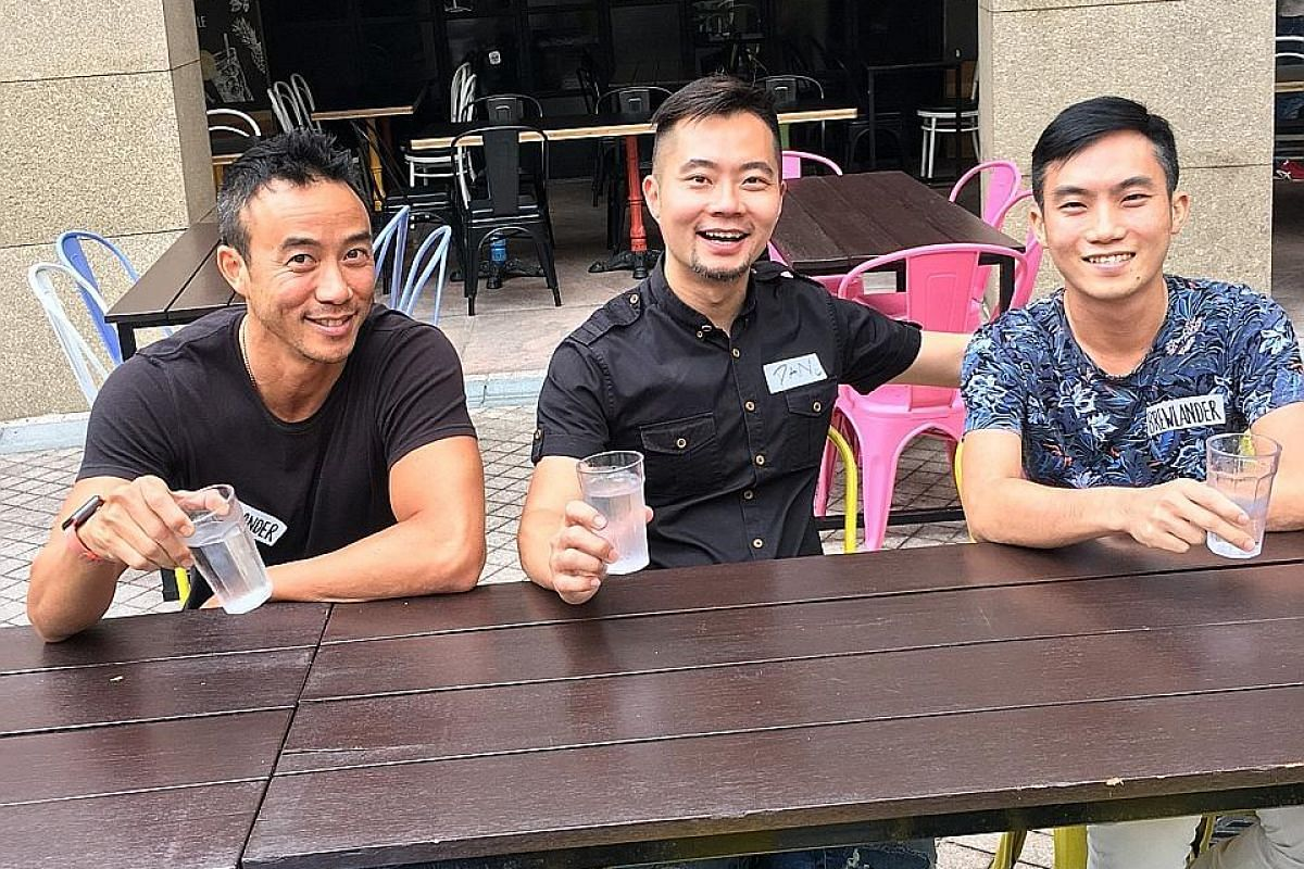 For those who like their beers hoppy, Joy (left) is a session Indian pale ale with 4.5 per cent alcohol. Brewlander & Co's (below from left) Allan Wu, Daniel Ong and John Wei.