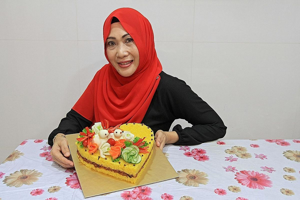 """The pulut kuning cake by Madam Julia Sallim has """"birds"""" made from eggs and vegetable """"flowers""""."""