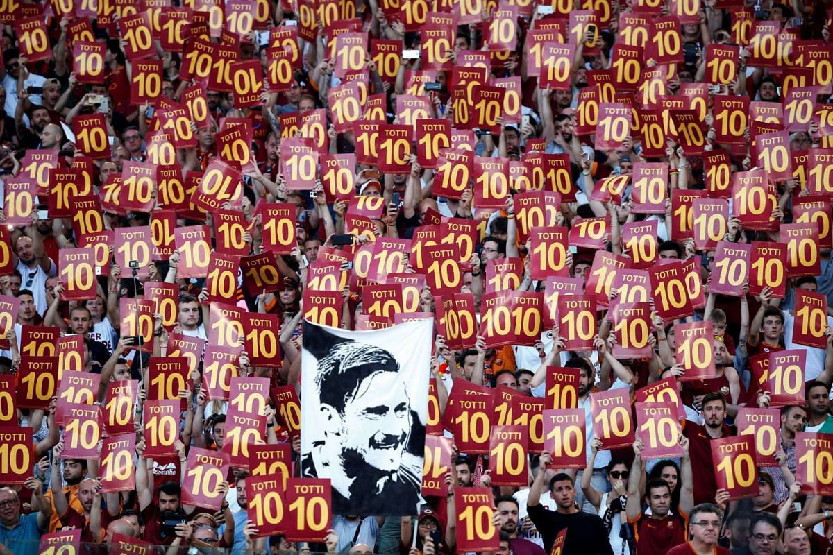 Roma fans display banners for Francesco Totti after his last game in Stadio Olimpico, Rome, Italy on May 28, 2017. PHOTO: REUTERS