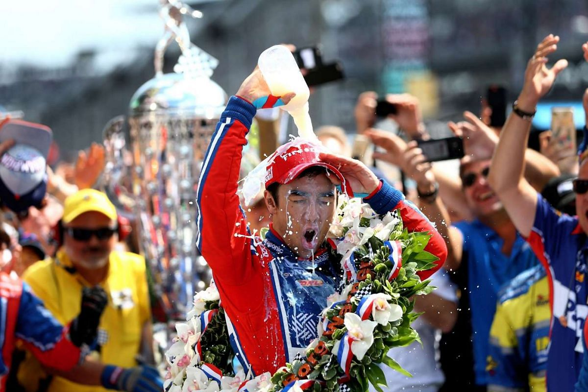 IndyCar Series driver Takuma Sato dumps milk on himself as he celebrates after winning the 101st Running of the Indianapolis 500 at Indianapolis Motor Speedway in Indianapolis, Indiana, USA on May 28, 2017. PHOTO: USA TODAY SPORTS