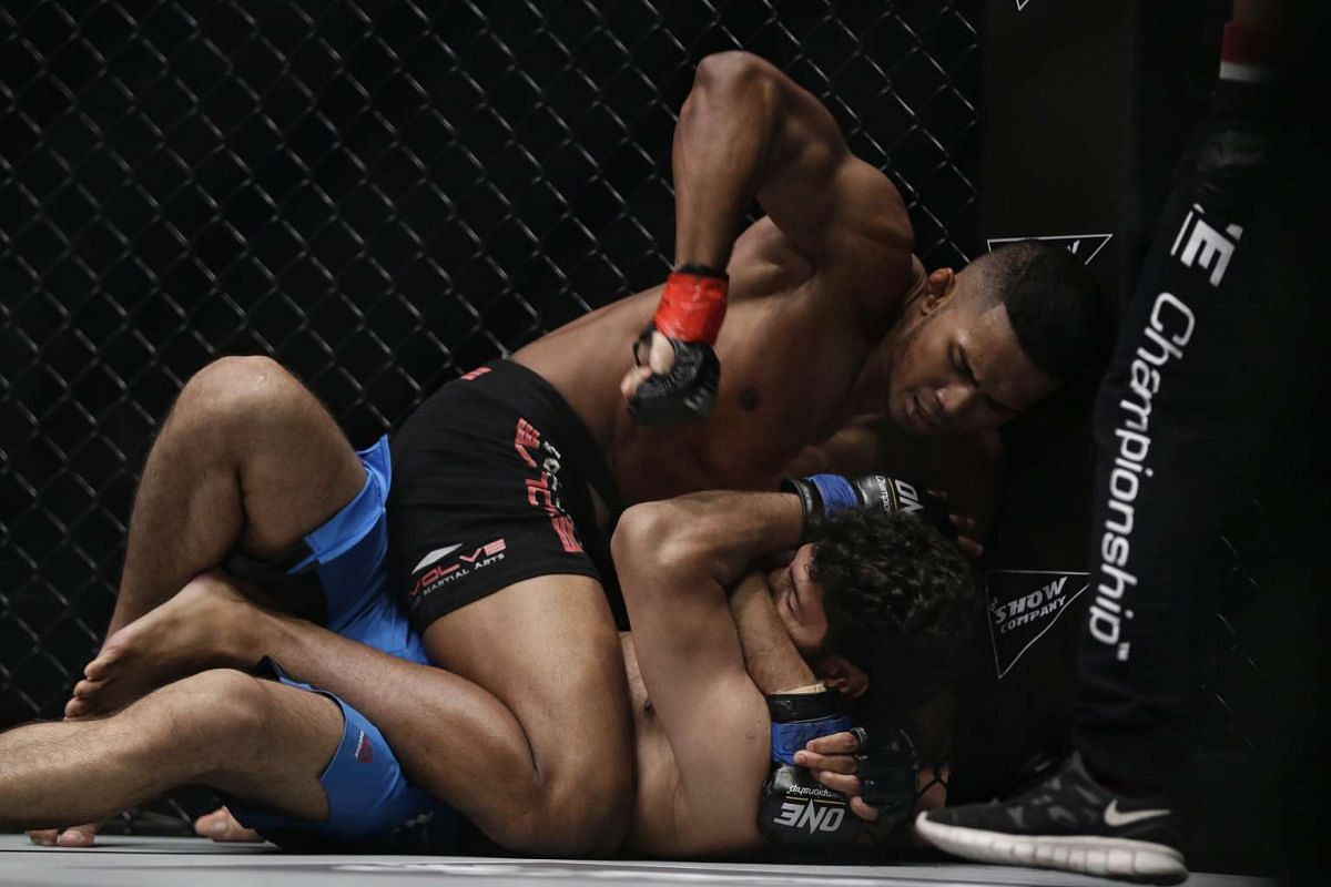 Singapore's mixed martial arts fighter Amir Khan pummelling India's Rajinder Singh Meena on his way to scoring a technical knockout win at One Championship's Dynasty of Heroes event held at the Singapore Indoor Stadium on May 26, 2017.