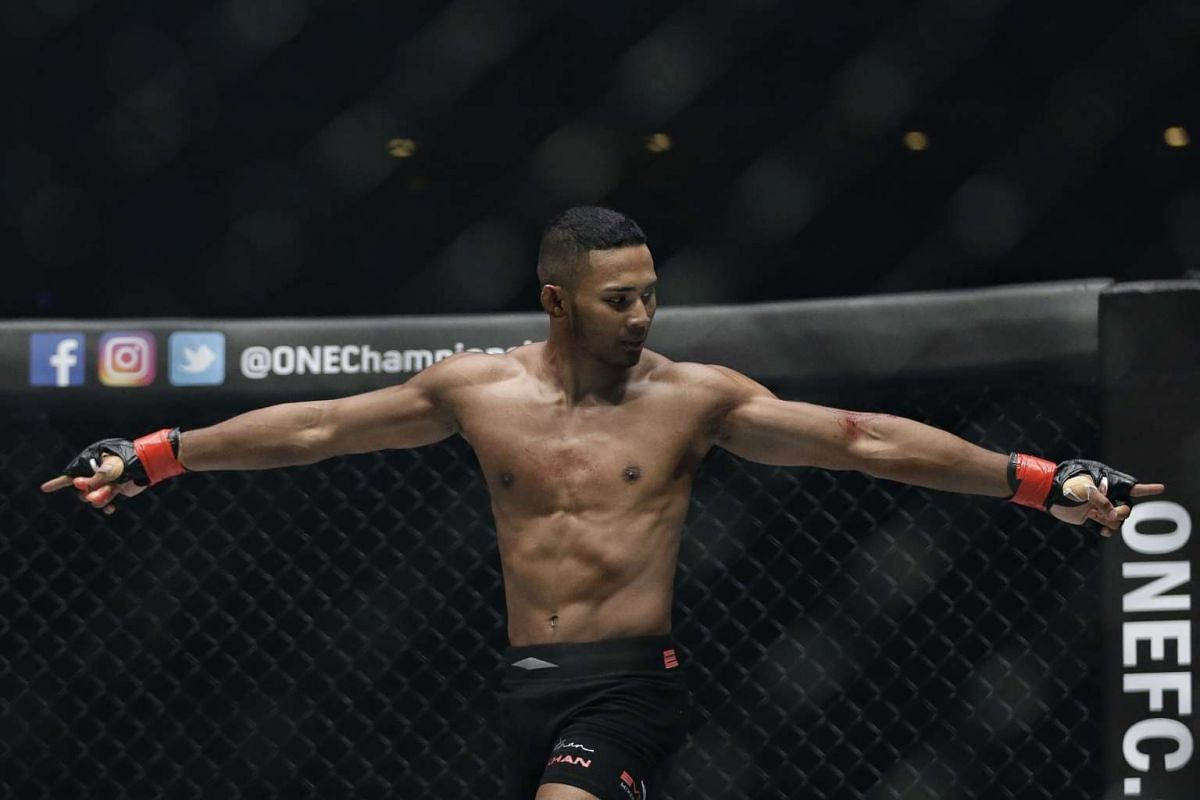 Amir Khan of Singapore gestures after beating Rajinder Singh Meena of India during ONE Championship's Dynasty of Heroes fight night at Singapore Indoor Stadium on May 26, 2017.