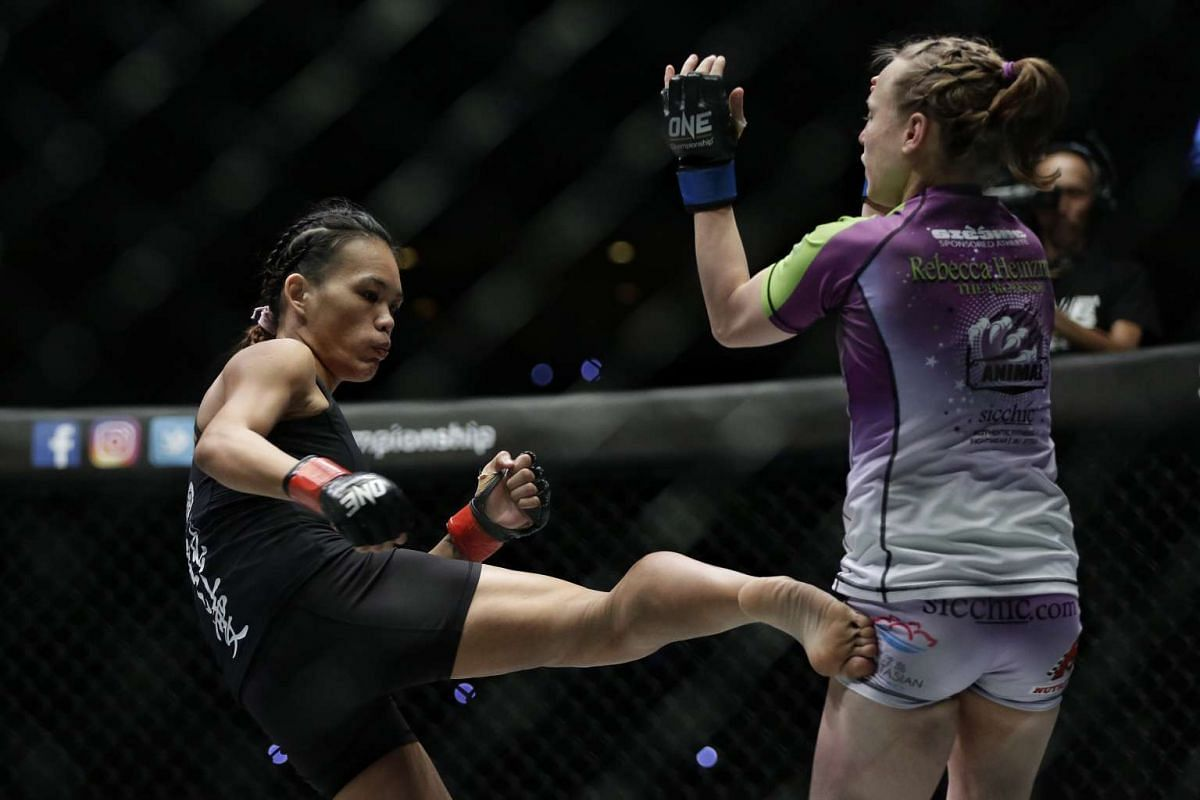 Tiffany Teo of Singapore kicking Rebecca Heintzman-Rozewski of USA during ONE Championship's Dynasty of Heroes fight night at Singapore Indoor Stadium on May 26, 2017.