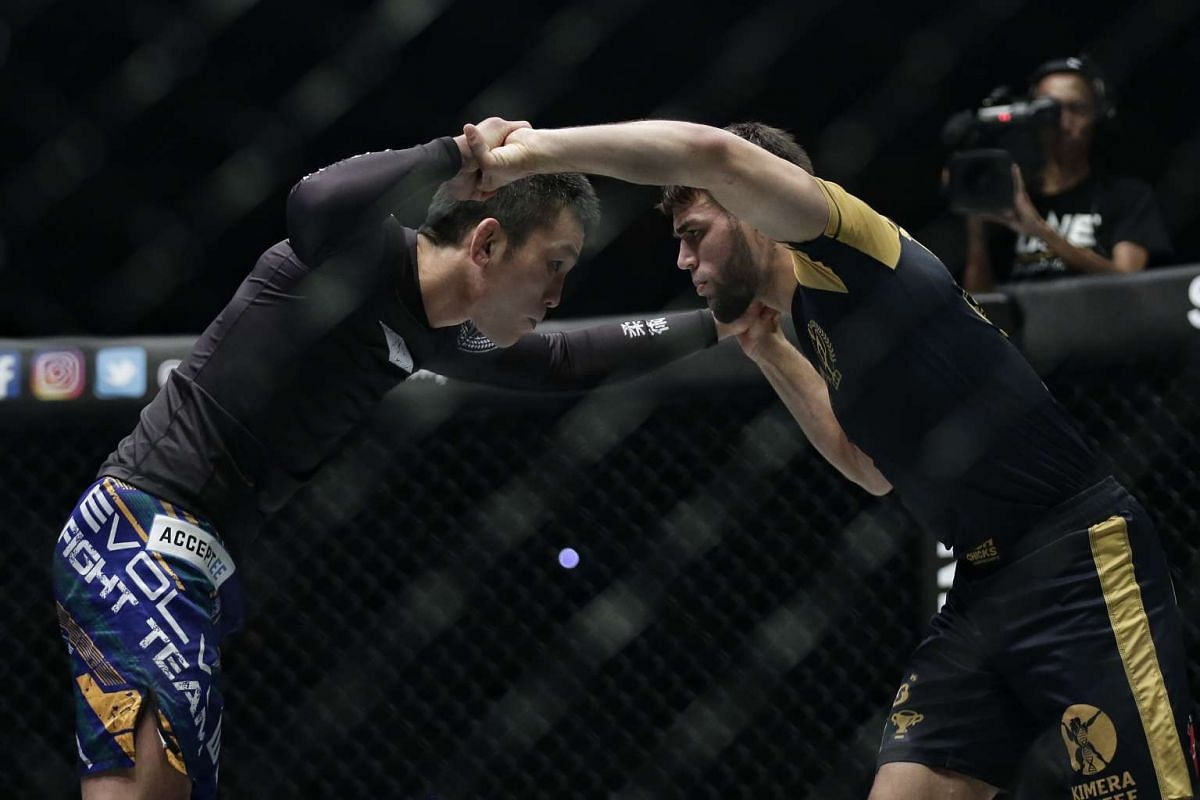 Shinya Aoki (left) of Japan in action against Garry Tonon of USA during the grappling super match of ONE Championship's Dynasty of Heroes fight night at Singapore Indoor Stadium on May 26, 2017.