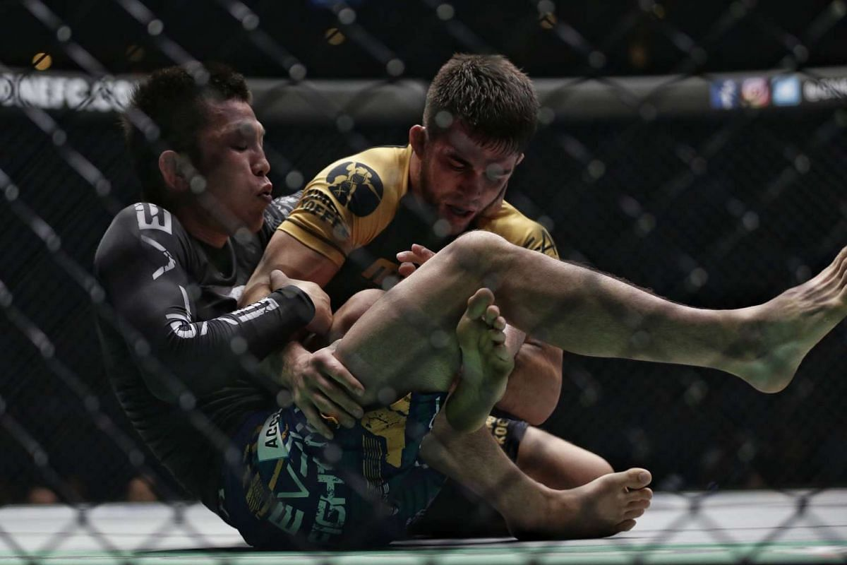 Garry Tonon (right) of USA locking up the leg of Japan's Shinya Aoki during the grappling super match of ONE Championship's Dynasty of Heroes fight night at Singapore Indoor Stadium on May 26, 2017.