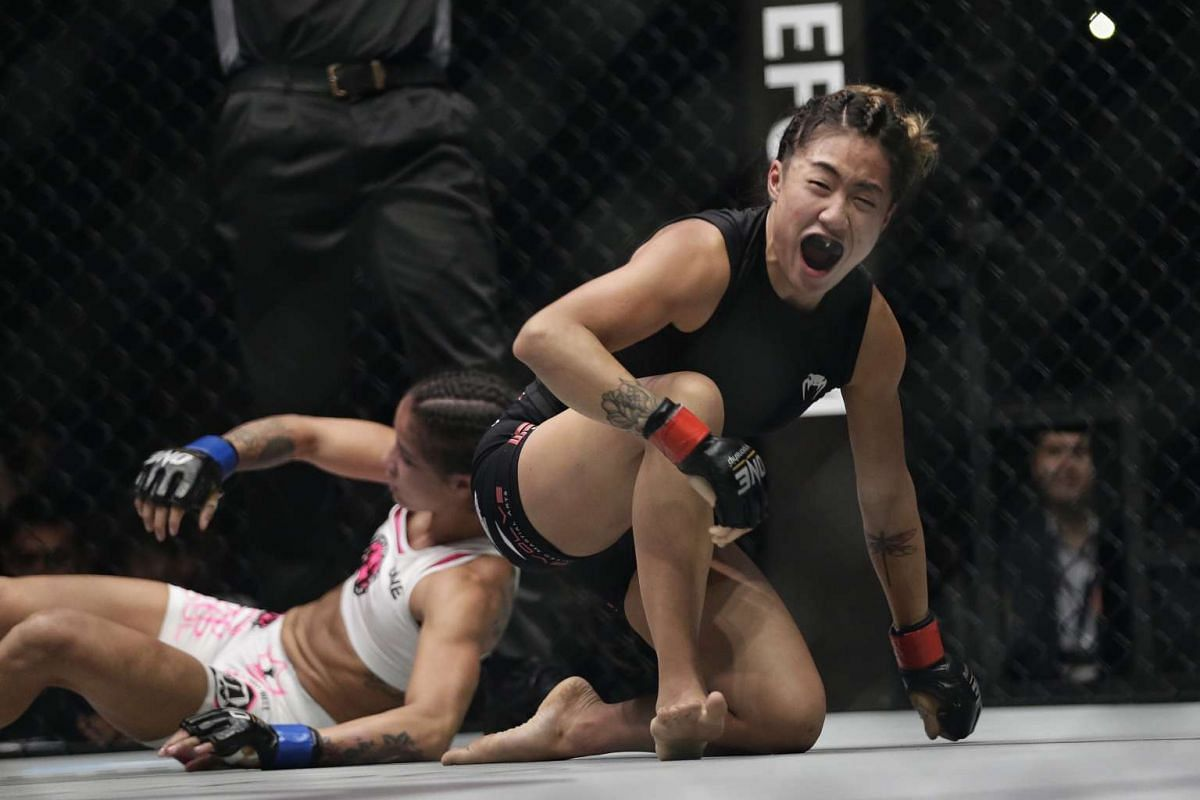 Atomweight champion Angela Lee reacts after defeating Istela Nunes in the main event of ONE Championship's Dynasty of Heroes fight night at Singapore Indoor Stadium on May 26, 2017.