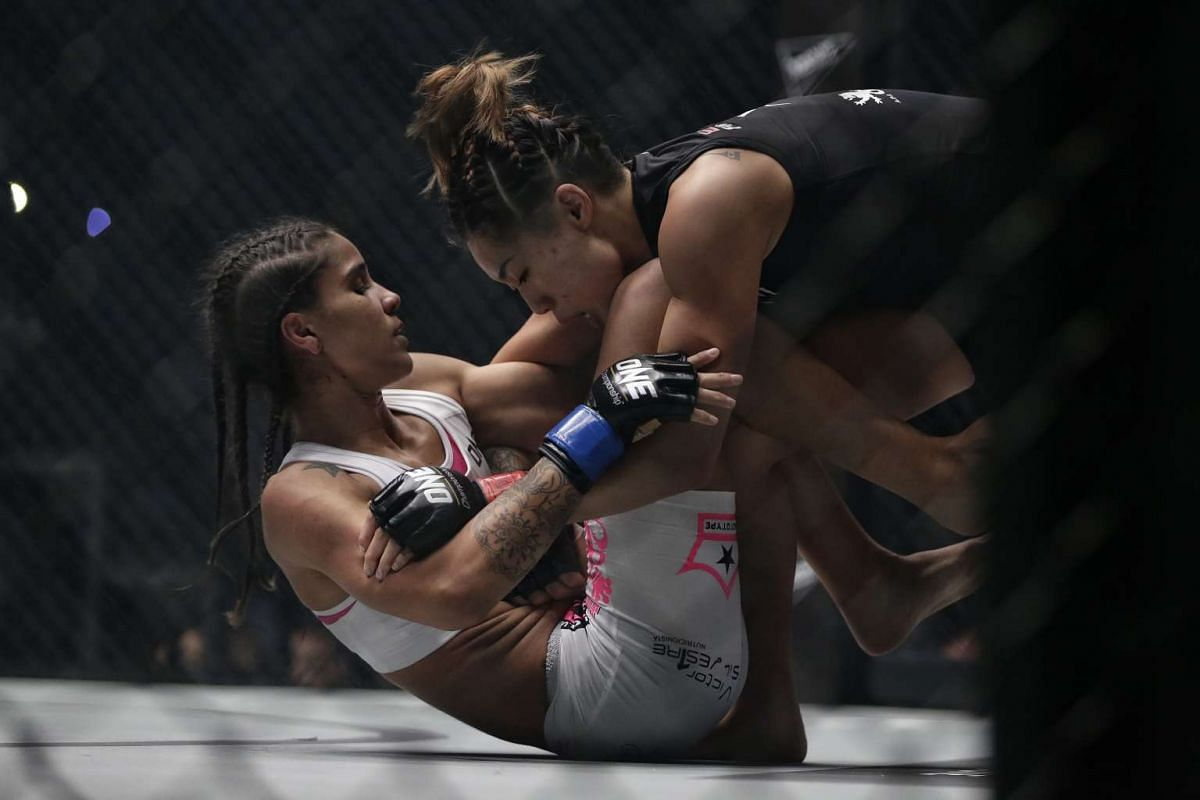 Atomweight champion Angela Lee grappling Istela Nunes to the ground in the main event of ONE Championship's Dynasty of Heroes fight night at Singapore Indoor Stadium on May 26, 2017.