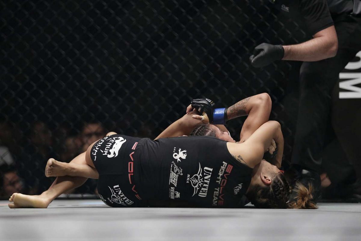 Atomweight champion Angela Lee executing a rear naked choke on Istela Nunes in the main event of ONE Championship's Dynasty of Heroes fight night at Singapore Indoor Stadium on May 26, 2017.