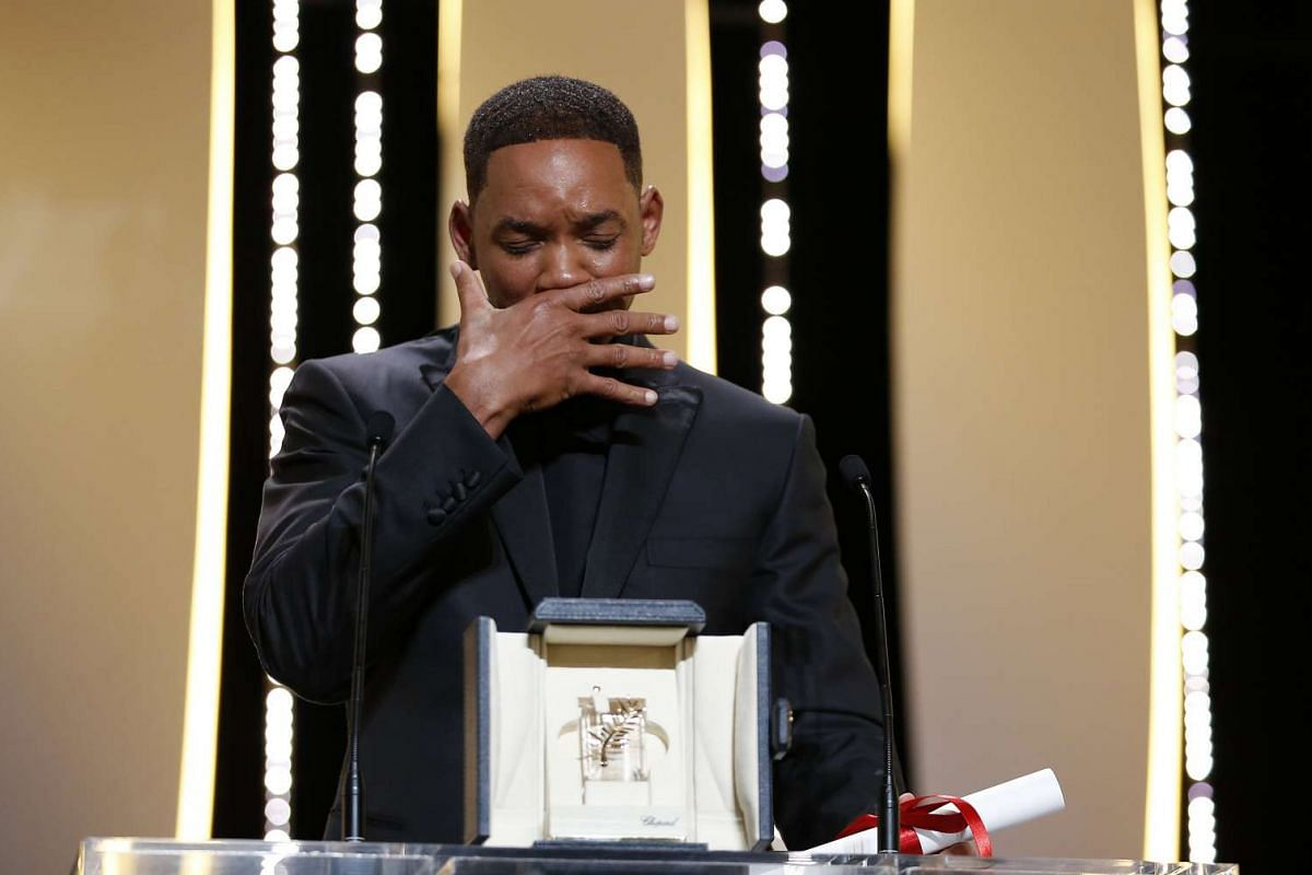 An emotional Will Smith accepts the 70th edition Special Prize on behalf of Australian actress Nicole Kidman.